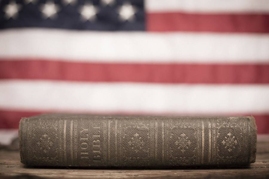bible-with-flag-in-background-900